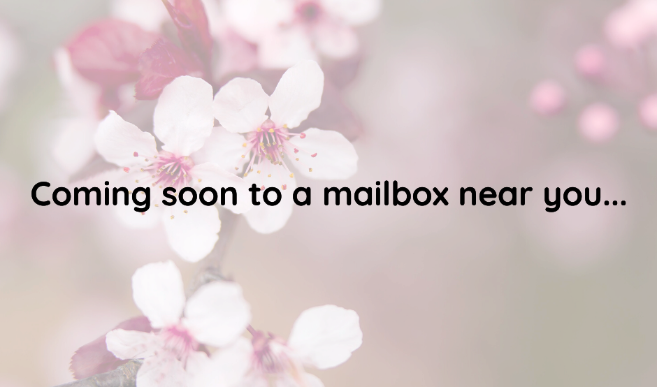 "Message ""Coming Soon to a Mailbox Near You..."" in black font on a background of pink flowers"