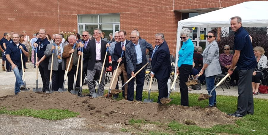 photo of hospital staff and other stakeholders and dignitaries holding shovels in a symbolic ground-breaking ceremony to celebrate the kick-off of the redevelopment project