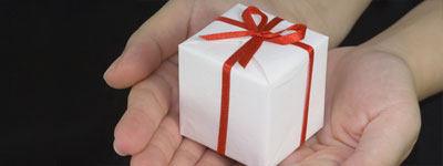photo of hands holding a gift